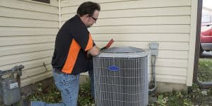 HVAC Contractor Checking AC